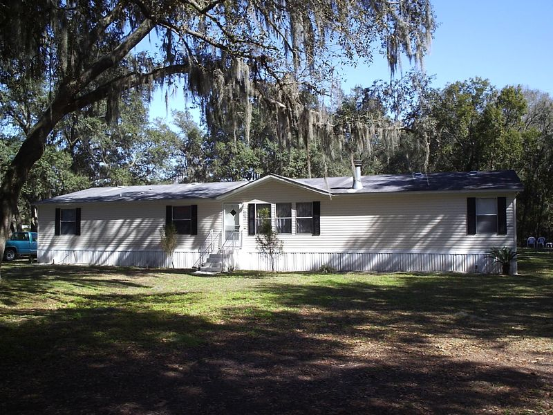 Price reduction on 4 bedroom 25 bath home on acre for Home furniture zephyrhills fl